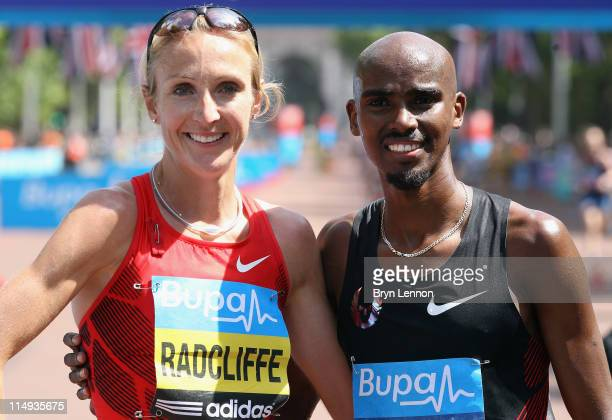 Paula Radcliffe of Great Britain poses with Mo Farah after the Bupa London 10000 Run on May 30 2011 in London England