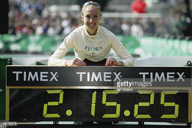 Paula Radcliffe of Great Britain with the womens elite trophy after the 2003 Flora London Marathon on April 13 2003 at the Mall in London England
