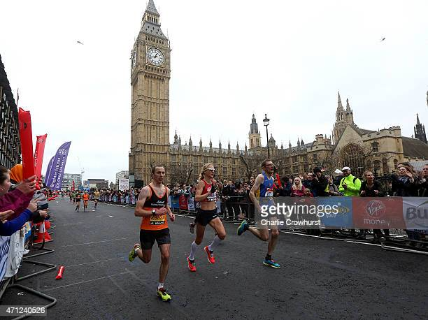 Paula Radcliffe runs past the Houses of Parliament during the Virgin Money London Marathon 2015 on April 26 2015 in London England
