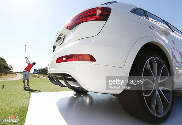 Paula Reto of South Africa hits a tee shot next to an Audi that is to win for a holeinone on the 7th tee during day two of the LPGA Australian Open...