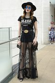Paula Sampaio is seen wearing Urban Outfitters skirt Forever 21 shirt Versace belt Chanel bag and vintage hat during MercedesBenz Fashion Week Spring...