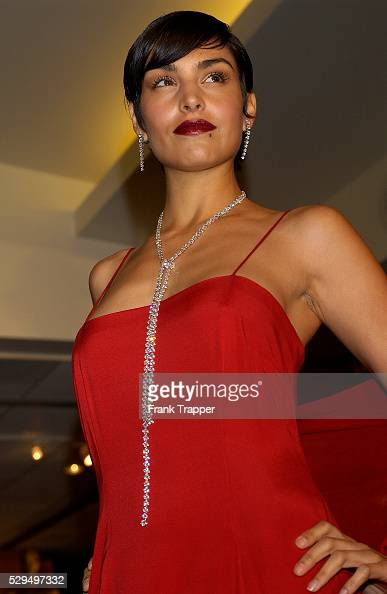 Paula wears David Rodriquez's red tiered slip gown with Martin Katz diamond rope chain 141 1 ct diamonds 3 row diamond drop earrings 39 cts at the...