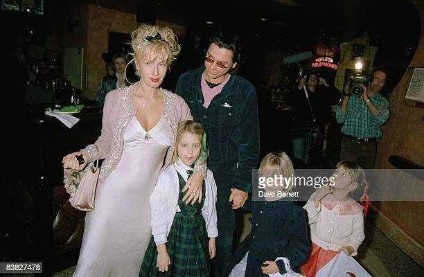 Paula Yates Michael Hutchence and Paula's children attend a charity premiere afterparty for 'A Little Princess' at Planet Hollywood in London 5th...