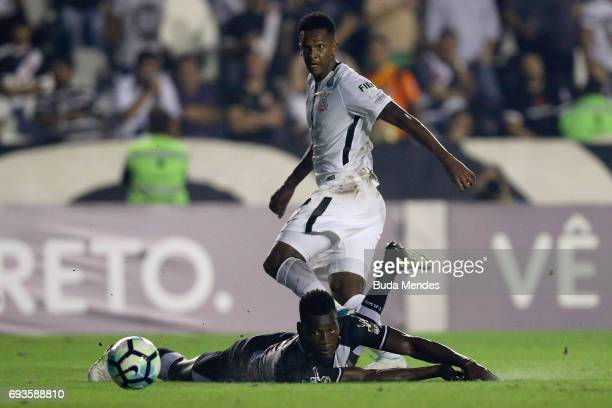 Paulao of Vasco da Gama struggles for the ball with Jo of Corinthians during a match between Vasco da Gama and Corinthians as part of Brasileirao...
