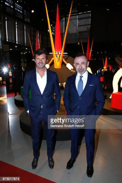 PaulEmmanuel Reiffers and Alain Seban pose in front the works of JeanPaul Goude during the 'Societe des Amis du Musee d'Art Moderne du Centre...