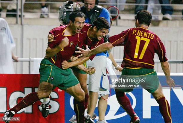 Pauleta of Portugal celebrates scoring his team's first goal with his team mates Sergio Conceicao and Paulo Bento during the FIFA World Cup...