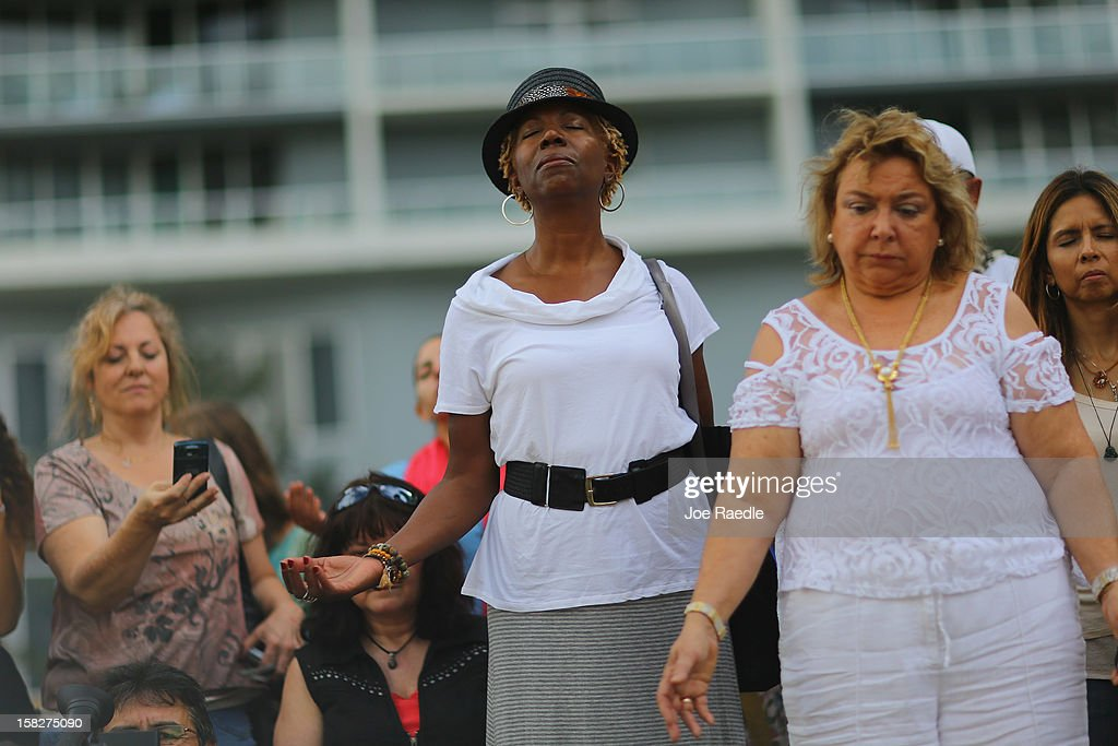 Paulette Hicks (C) and others participate in a sacred 12.12.12 ceremony with ancient crystal skulls at Miami Circle which is a Tequesta indian site used centuries ago on December 12, 2012 in Miami, United States. The ceremony was held on the calender date of 12-12-12 which is the last major numerical date using the Gregorian or Christian calendar for almost another century.
