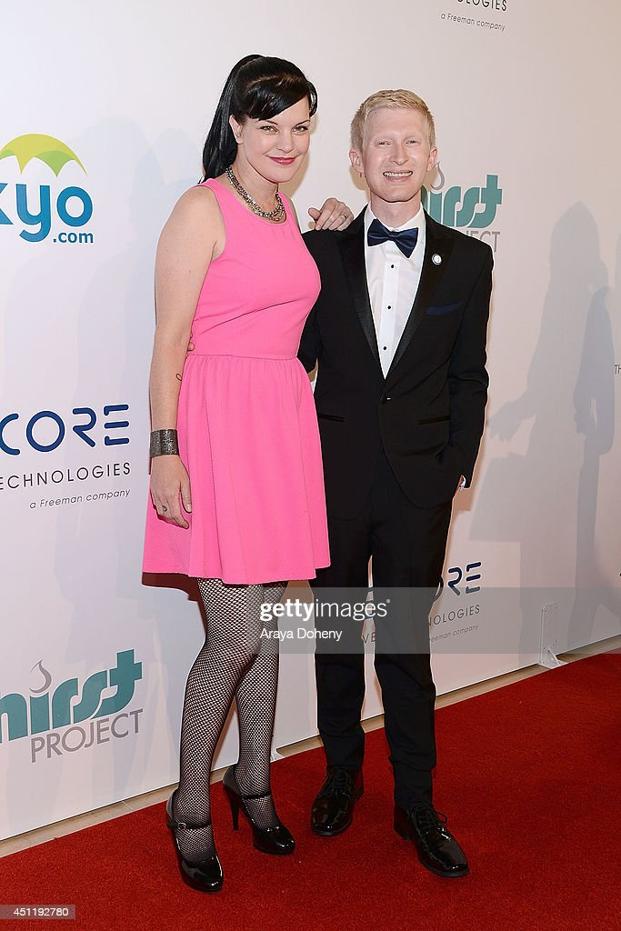 Pauley Perrette and <a gi-track='captionPersonalityLinkClicked' href=/galleries/search?phrase=Seth+Maxwell&family=editorial&specificpeople=7074410 ng-click='$event.stopPropagation()'>Seth Maxwell</a> attend the 5th Annual Thirst Gala hosted by Jennifer Garner in partnership with Skyo and Relativity's 'Earth To Echo' at The Beverly Hilton Hotel on June 24, 2014 in Beverly Hills, California.