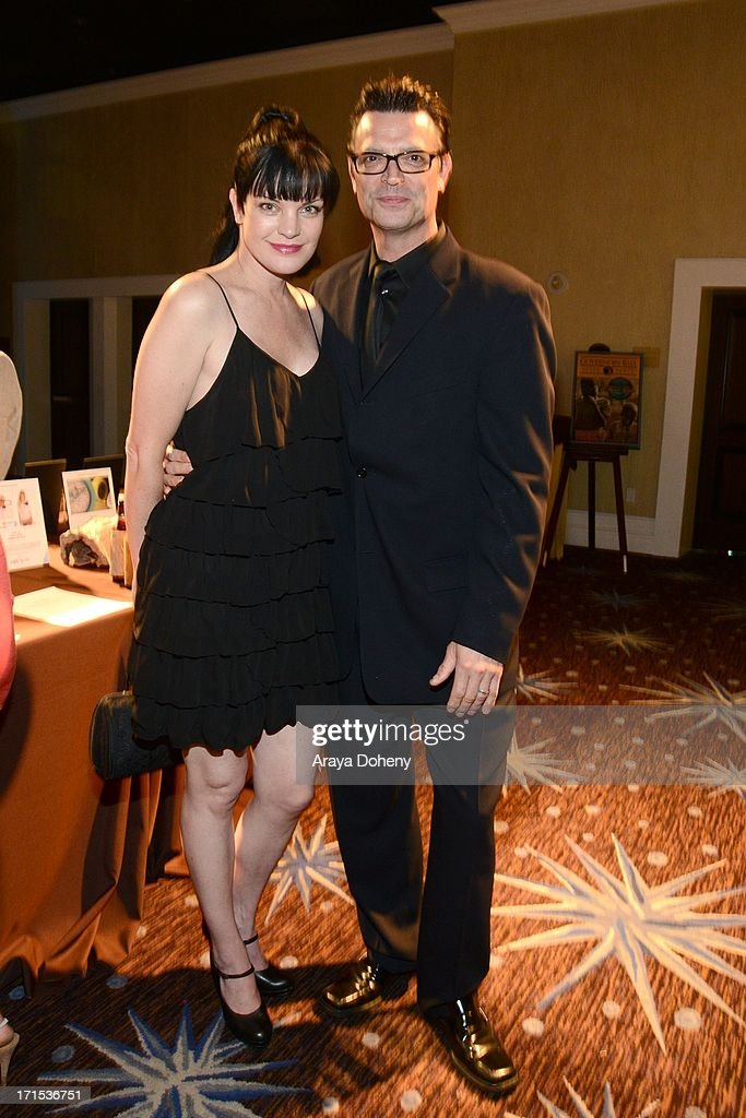 Pauley Perrette and Thomas Arklie at The Thirst Project 4th annual gala and performance at The Beverly Hilton Hotel on June 25, 2013 in Beverly Hills, California.
