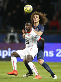 PaulGeorges Ntep of Rennes and David Luiz of PSG in action during the French Ligue 1 match between Paris SaintGermain FC and Stade Rennais FC at Parc...