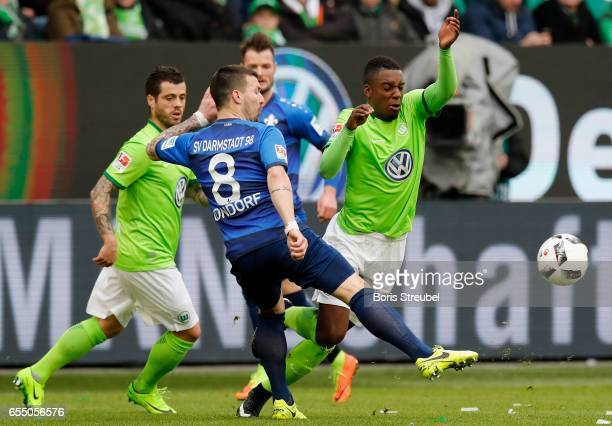 PaulGeorges Ntep of VfL Wolfsburg is challenged by Jerome Gondorf of SV Darmstadt 98 during the Bundesliga match between VfL Wolfsburg and SV...