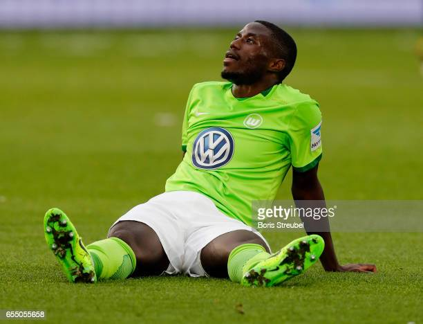 PaulGeorges Ntep of VfL Wolfsburg takes an injury during the Bundesliga match between VfL Wolfsburg and SV Darmstadt 98 at Volkswagen Arena on March...