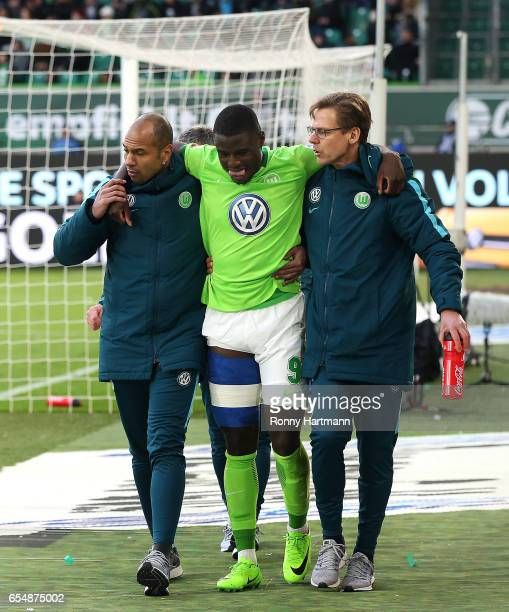 PaulGeorges Ntep of Wolfsburg leaves the pitch with an injury during the Bundesliga match between VfL Wolfsburg and SV Darmstadt 98 at Volkswagen...