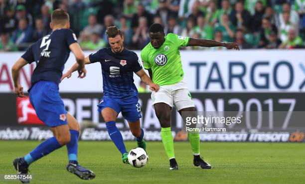 PaulGeorges Ntep of Wolfsburg vies with Gustav Valsvik of Braunschweig during the Bundesliga Playoff first leg match between VfL Wolfsburg and...