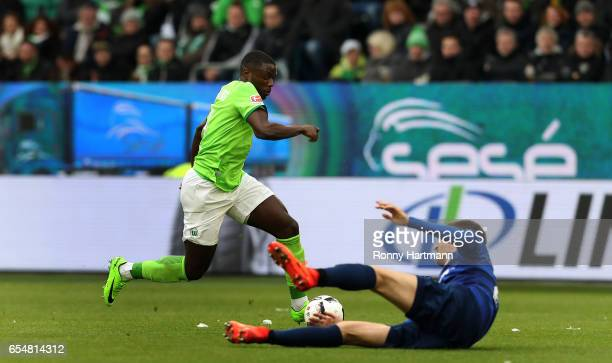 PaulGeorges Ntep of Wolfsburg vies with Patrick Banggaard of Darmstadt during the Bundesliga match between VfL Wolfsburg and SV Darmstadt 98 at...