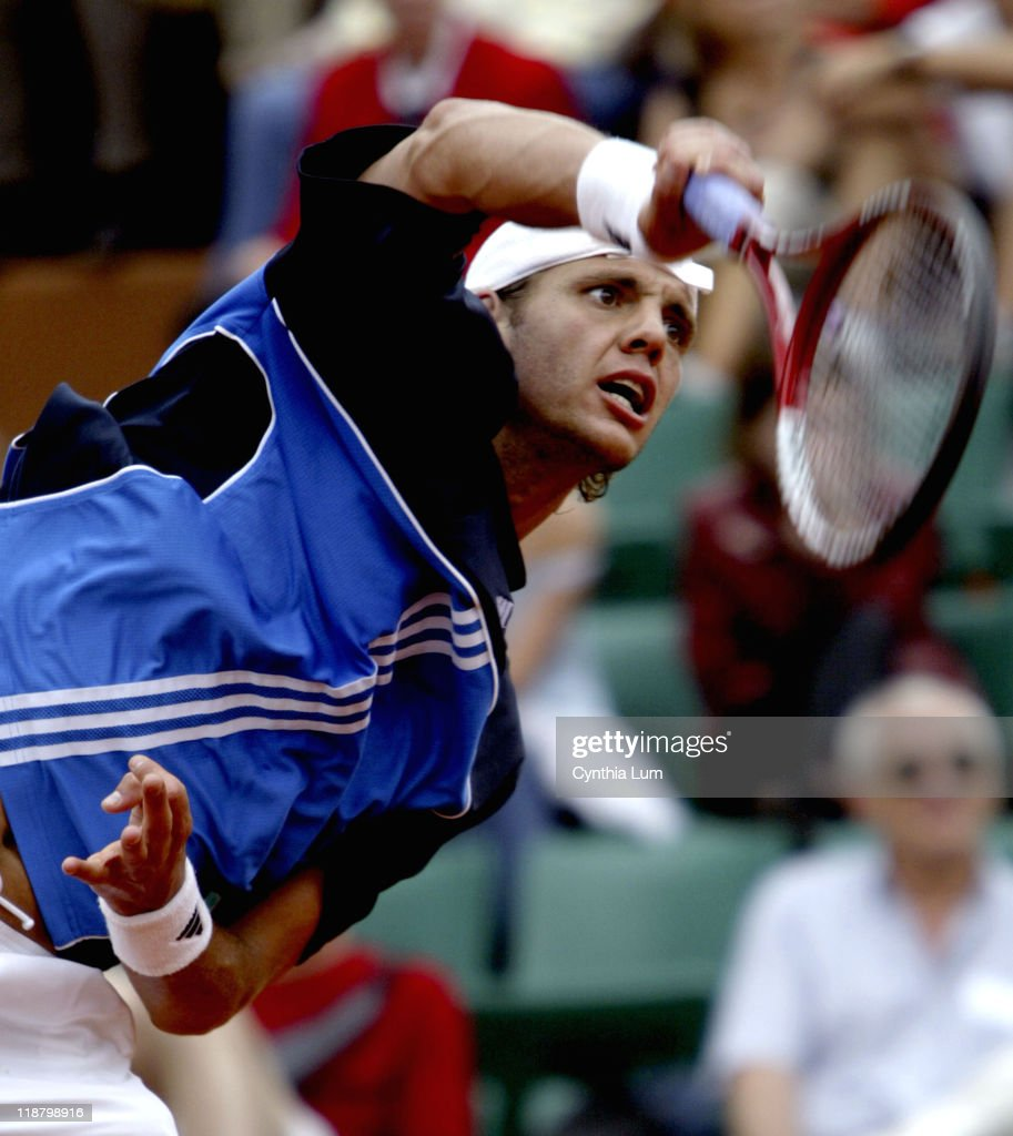 Paul-Henri Mathieu attacks the ball. Guillermo Canas defeated John Henri Mathieu 6-3, 7-6, 2-6, 6-7, 8-6 in the third round of the 2005 French Open at Roland Garros Stadium in Paris, France, on May 29, 2005.