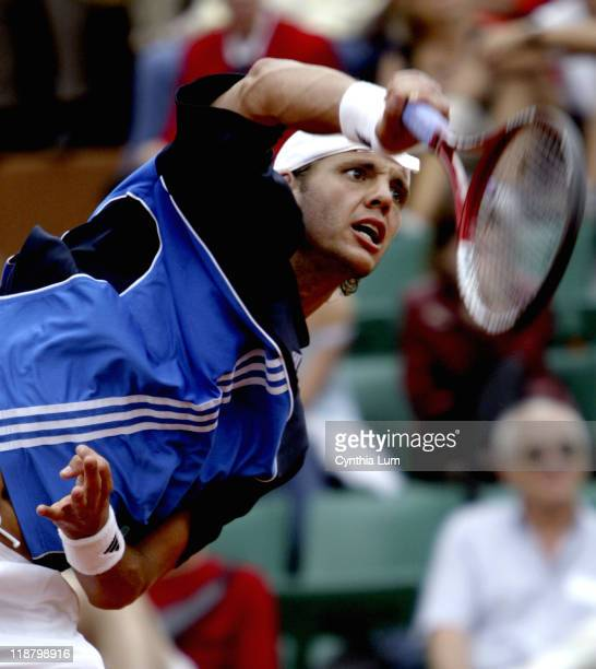 PaulHenri Mathieu attacks the ball Guillermo Canas defeated John Henri Mathieu 63 76 26 67 86 in the third round of the 2005 French Open at Roland...