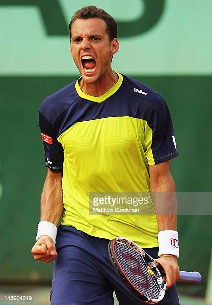 PaulHenri Mathieu of France celebrates a point during his men's singles third round match against Marcel Granollers of Spain during day seven of the...