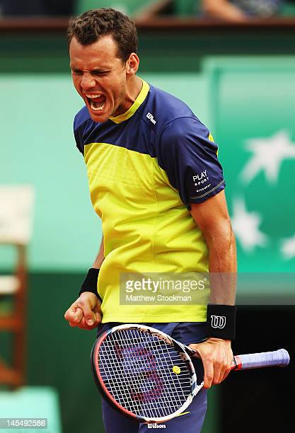 PaulHenri Mathieu of France celebrates a point in his men's singles second round match against John Isner of USA during day 5 of the French Open at...