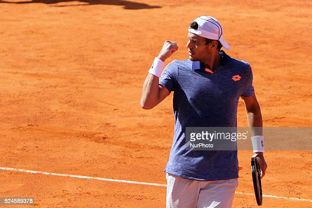 PaulHenri Mathieu of France celebrates his victory over Gastao Elias of Portugal during the Millennium Estoril Open ATP 250 tennis tournament at the...
