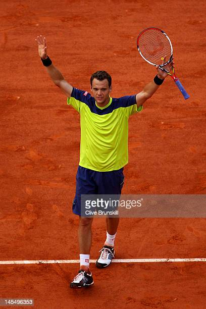 PaulHenri Mathieu of France celebrates match point in his men's singles second round match against John Isner of USA during day 5 of the French Open...