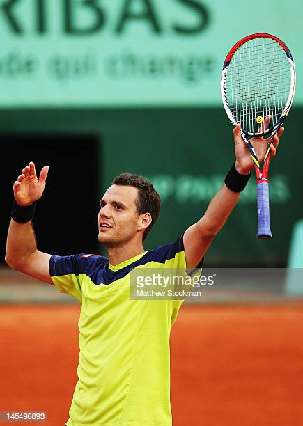 PaulHenri Mathieu of France celebrates victory in his men's singles second round match against John Isner of USA during day 5 of the French Open at...