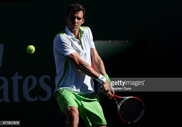 PaulHenri Mathieu of France hits a retrun to Roger Federer of Switzerland during the BNP Paribas Open at Indian Wells Tennis Garden on March 8 2014...