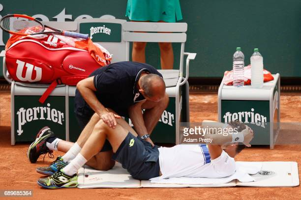 PaulHenri Mathieu of France is given treatment from the physio during the mens singles first round match against David Goffin of Belgium on day two...