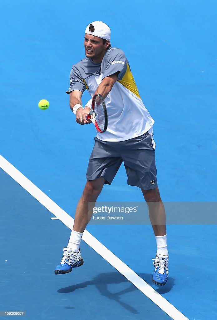 <a gi-track='captionPersonalityLinkClicked' href=/galleries/search?phrase=Paul-Henri+Mathieu&family=editorial&specificpeople=221609 ng-click='$event.stopPropagation()'>Paul-Henri Mathieu</a> of France plays a backhand during his match against Kei Nishikori of Japan during day three of the AAMI Classic at Kooyong on January 11, 2013 in Melbourne, Australia.