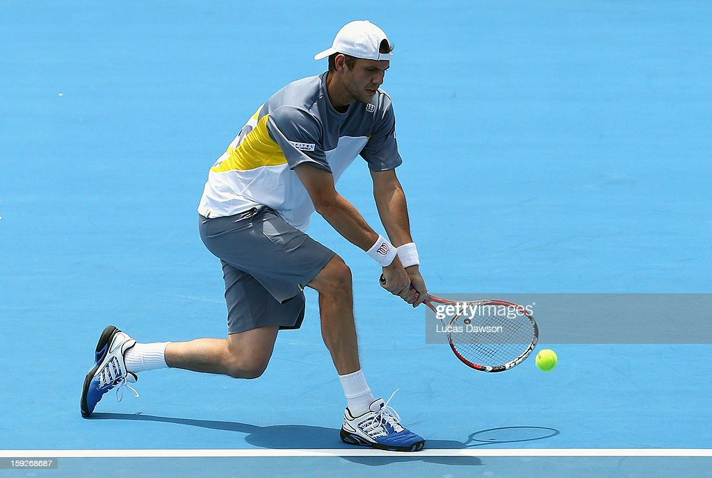 Paul-Henri Mathieu of France plays a backhand during his match against Kei Nishikori of Japan during day three of the AAMI Classic at Kooyong on January 11, 2013 in Melbourne, Australia.