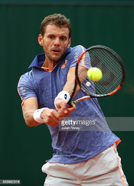 PaulHenri Mathieu of France plays a backhand during the Men's Singles first round match against Santiago Giraldo of Columbia on day three of the 2016...