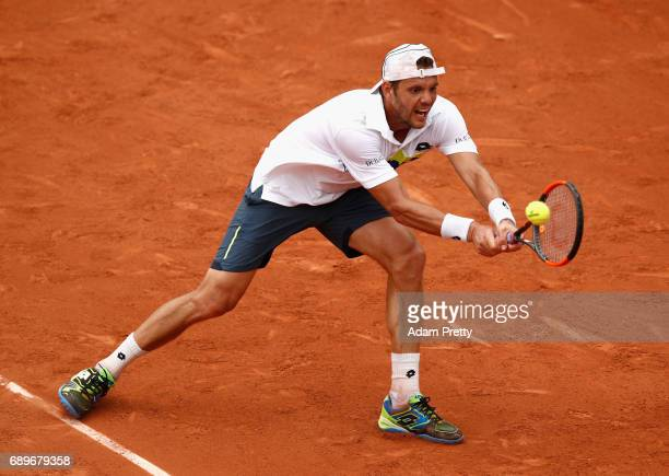 PaulHenri Mathieu of France plays a backhand during the mens singles first round match against David Goffin of Belgium on day two of the 2017 French...