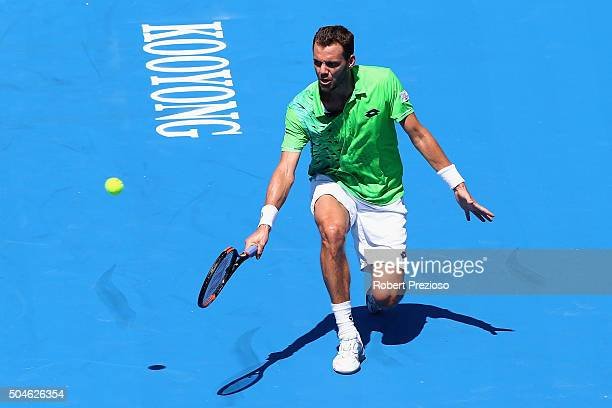PaulHenri Mathieu of France plays a backhand in his match against Nicolas Almagro of Spain during day one of the 2016 Kooyong Classic at Kooyong on...