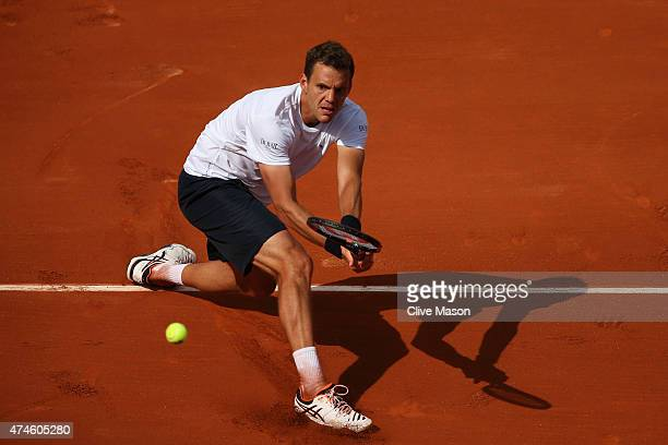 PaulHenri Mathieu of France plays a backhand in his Men's Singles match against Kei Nishikori of Japan on day one of the 2015 French Open at Roland...
