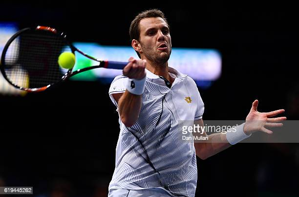 PaulHenri Mathieu of France plays a forehand against Marcos Baghdatis of Cyrpus during the Mens Singles first round match on day one of the BNP...