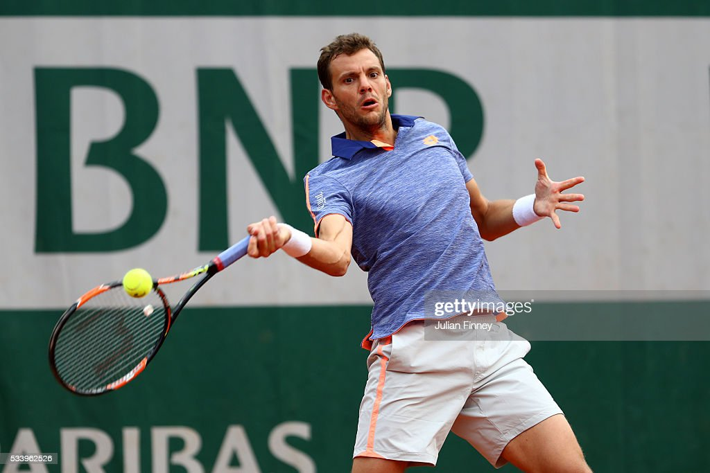 <a gi-track='captionPersonalityLinkClicked' href=/galleries/search?phrase=Paul-Henri+Mathieu&family=editorial&specificpeople=221609 ng-click='$event.stopPropagation()'>Paul-Henri Mathieu</a> of France plays a forehand during the Men's Singles first round match against Santiago Giraldo of Columbia on day three of the 2016 French Open at Roland Garros on May 24, 2016 in Paris, France.