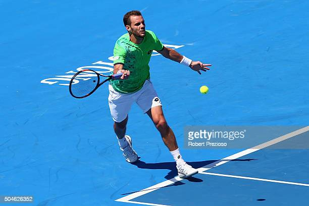 PaulHenri Mathieu of France plays a forehand in his match against Nicolas Almagro of Spain during day one of the 2016 Kooyong Classic at Kooyong on...