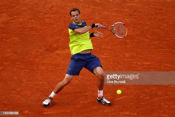 PaulHenri Mathieu of France plays a forehand in his men's singles second round match against John Isner of USA during day 5 of the French Open at...