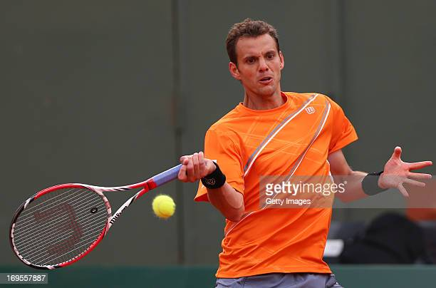 PaulHenri Mathieu of France plays a forehand in his Men's Singles match against Jarkko Nieminen of Finland during day two of the French Open at...