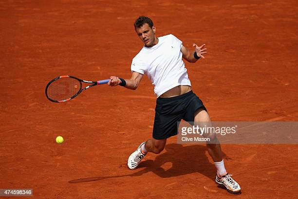 PaulHenri Mathieu of France plays a forehand in his Men's Singles match against Kei Nishikori of Japan on day one of the 2015 French Open at Roland...
