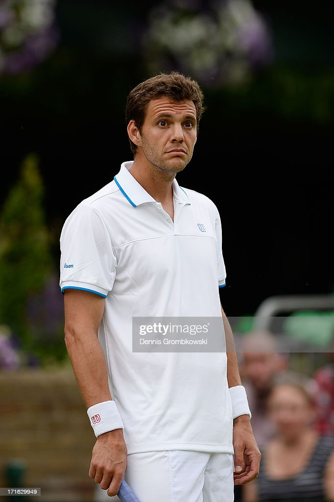Paul-Henri Mathieu of France reacts during his Gentlemen's Singles second round match against Feliciano Lopez of Spain on day four of the Wimbledon Lawn Tennis Championships at the All England Lawn Tennis and Croquet Club on June 27, 2013 in London, England.