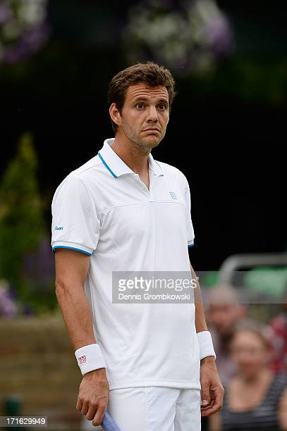 PaulHenri Mathieu of France reacts during his Gentlemen's Singles second round match against Feliciano Lopez of Spain on day four of the Wimbledon...
