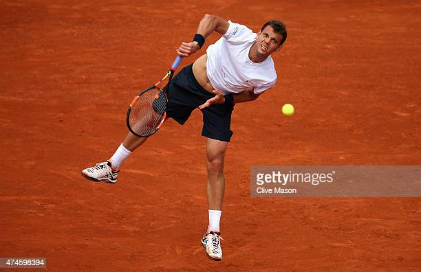 PaulHenri Mathieu of France serves in his Men's Singles match against Kei Nishikori of Japan on day one of the 2015 French Open at Roland Garros on...