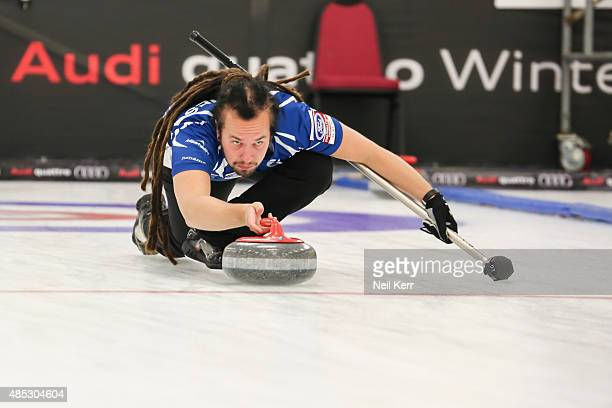 Pauli Jaamies of Finland delivers his shot against USA in the Curling Mixed Doubles Semi Finals during the Winter Games NZ at Naseby Curling Rink on...