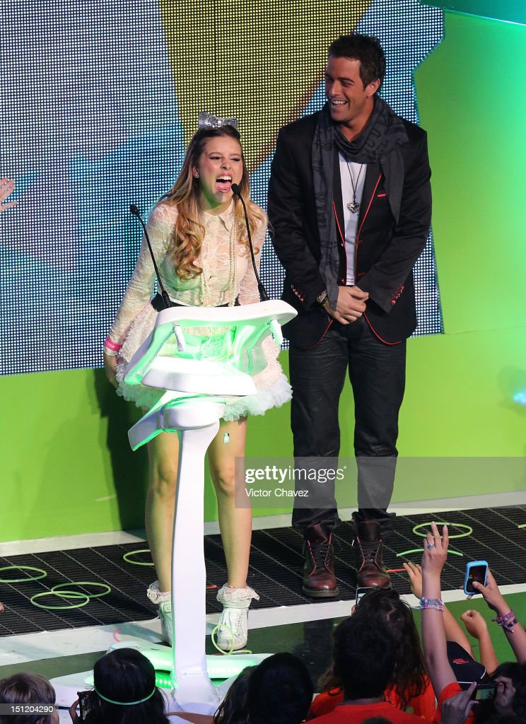 Paulina Goto winner of favorite actress award and Mane de la Parra speak onstage at the Kids Choice Awards Mexico 2012 at Pepsi Center WTC on September 1, 2012 in Mexico City, Mexico.