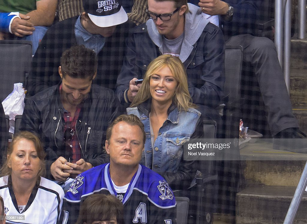 <a gi-track='captionPersonalityLinkClicked' href=/galleries/search?phrase=Paulina+Gretzky&family=editorial&specificpeople=2646375 ng-click='$event.stopPropagation()'>Paulina Gretzky</a> attends an NHL playoff game between the Chicago Blackhawks and the Los Angeles Kings at Staples Center on June 6, 2013 in Los Angeles, California.
