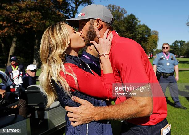 Paulina Gretzky kisses Dustin Johnson of the United States after the end of the round during morning foursome matches of the 2016 Ryder Cup at...