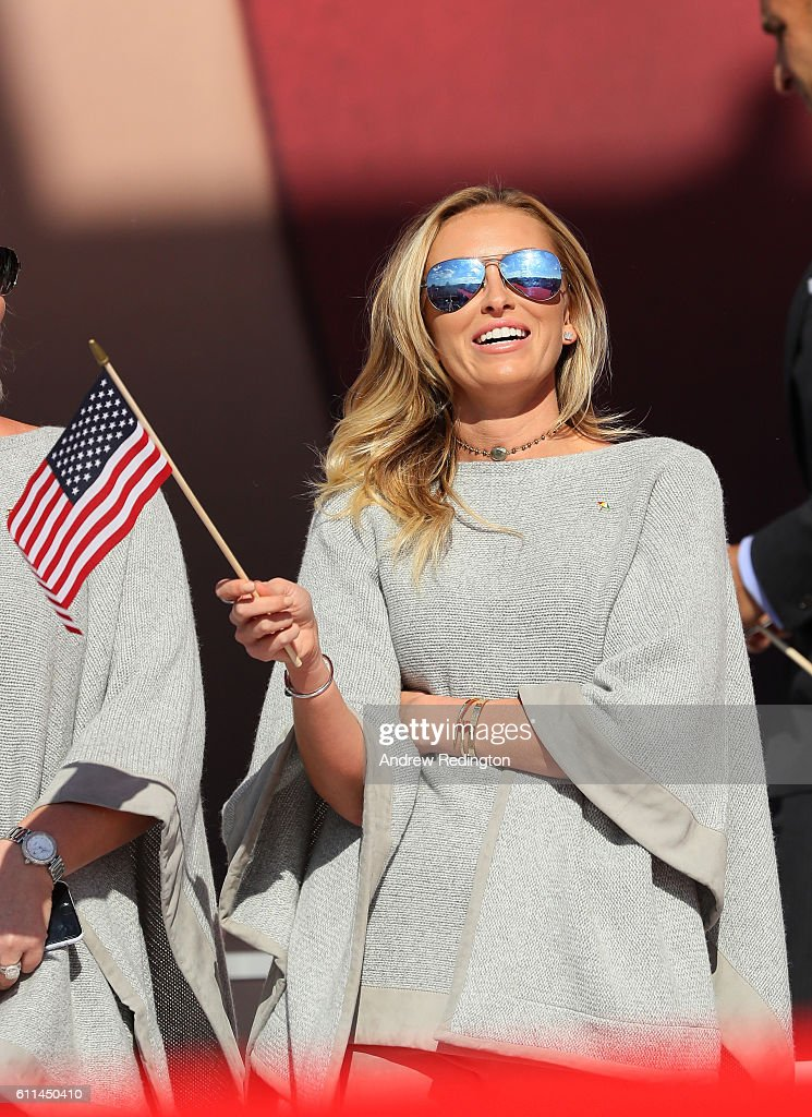 Paulina Gretzky waves a flag during the 2016 Ryder Cup Opening Ceremony at Hazeltine National Golf Club on September 29, 2016 in Chaska, Minnesota.