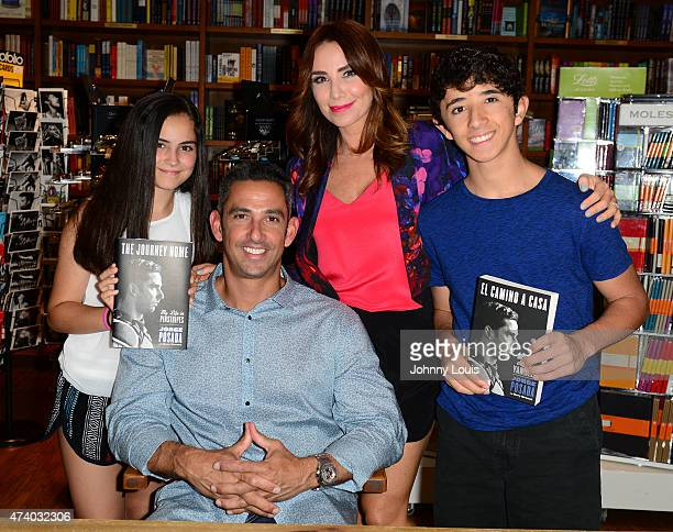Paulina Posada Jorge Posada Laura Posada and Jorge Posada Jr pose with family after greeting fans and signs copies of his book 'The Journey Home My...