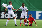 Paulina Solis of Mexico is challenged by Nikita Parris and Katie Zelem of England during the FIFA U20 Women's World Cup Canada 2014 group C match...